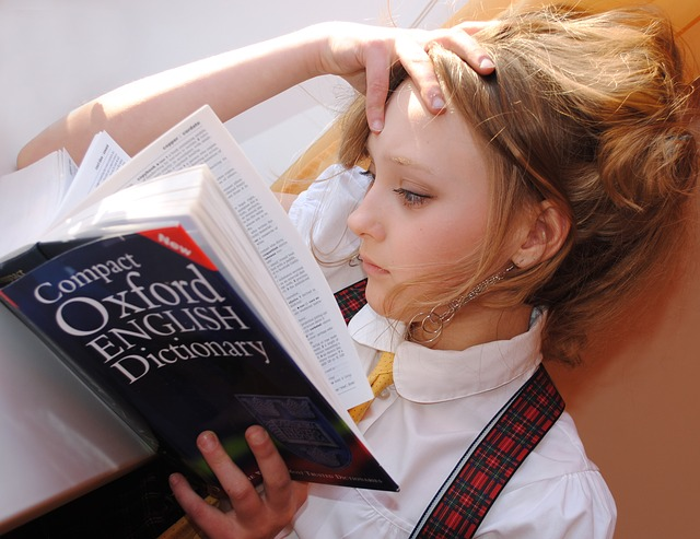 girl reading about adverbs