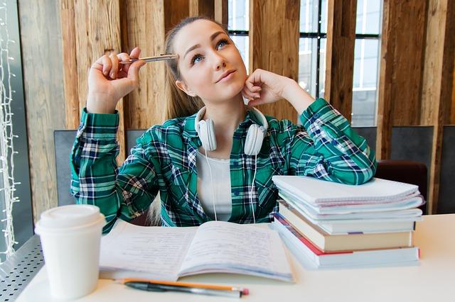 girl writing an argumentative essay